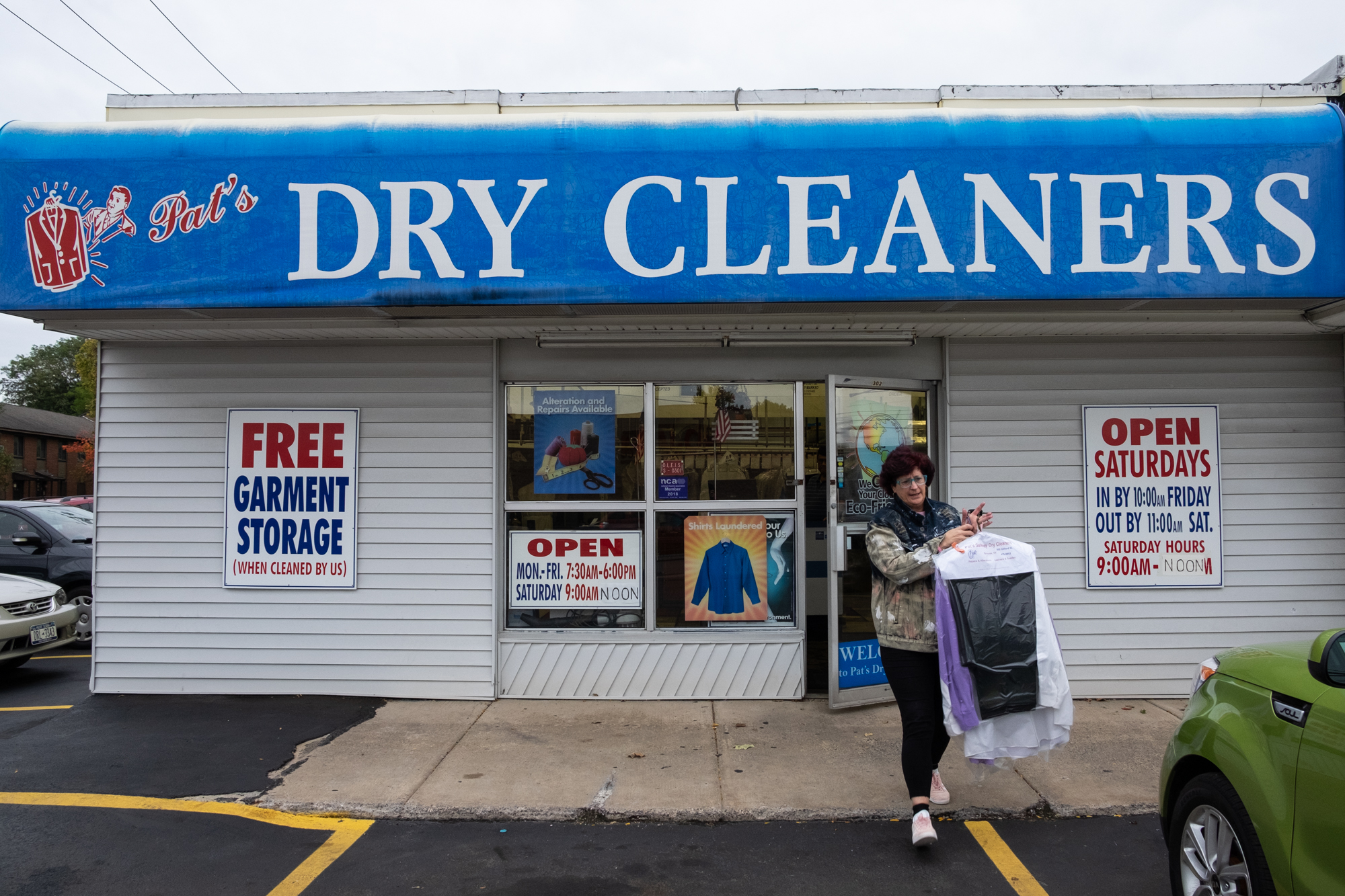 Woman in front of dry cleaners