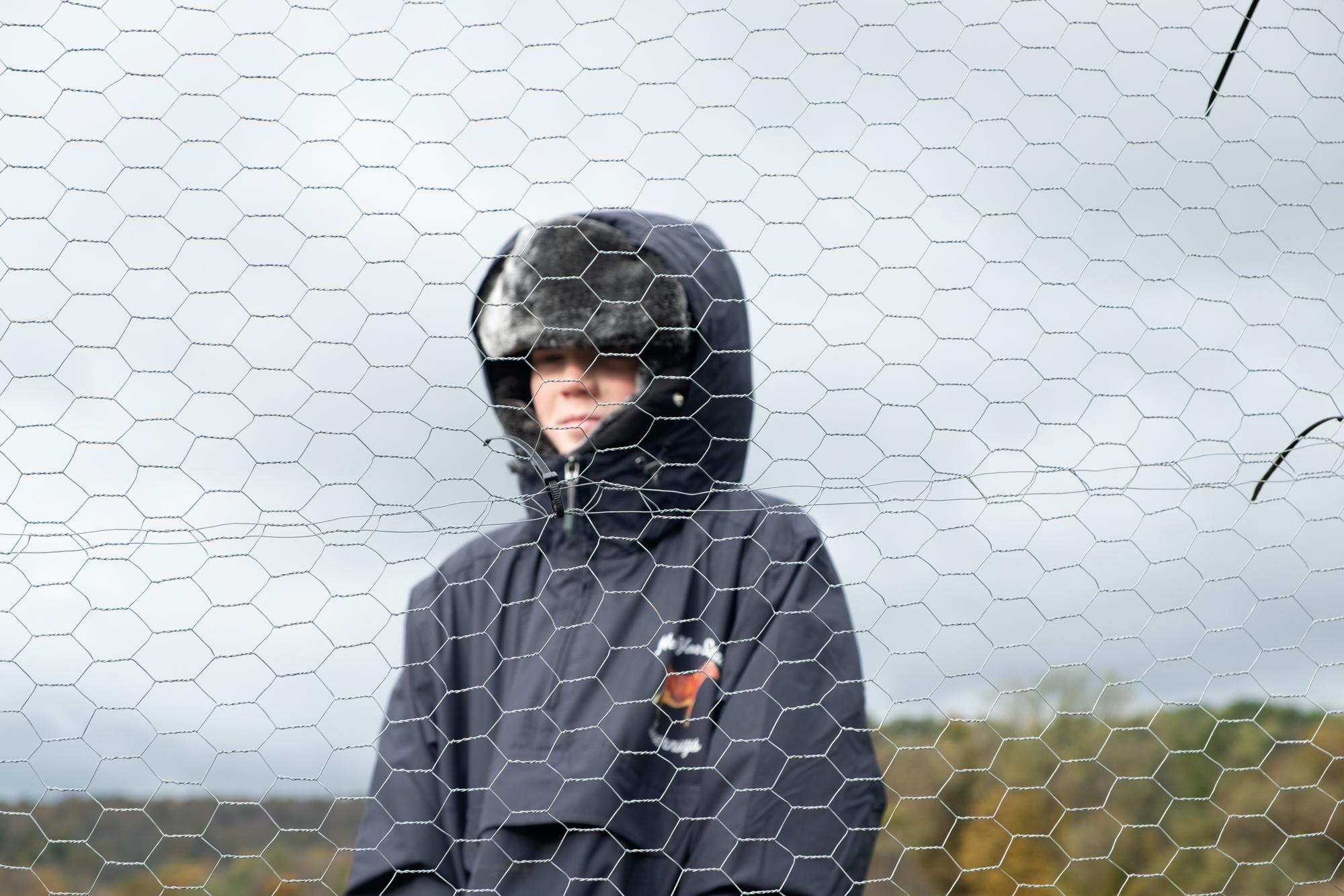 boy outside chicken coop