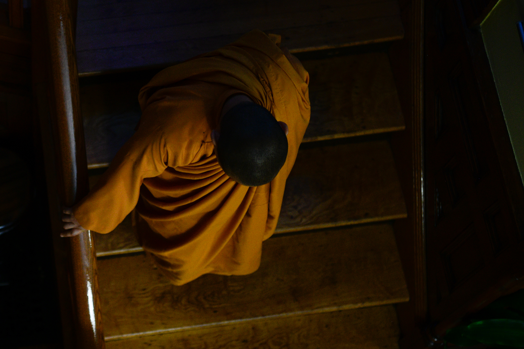 nun on stairs