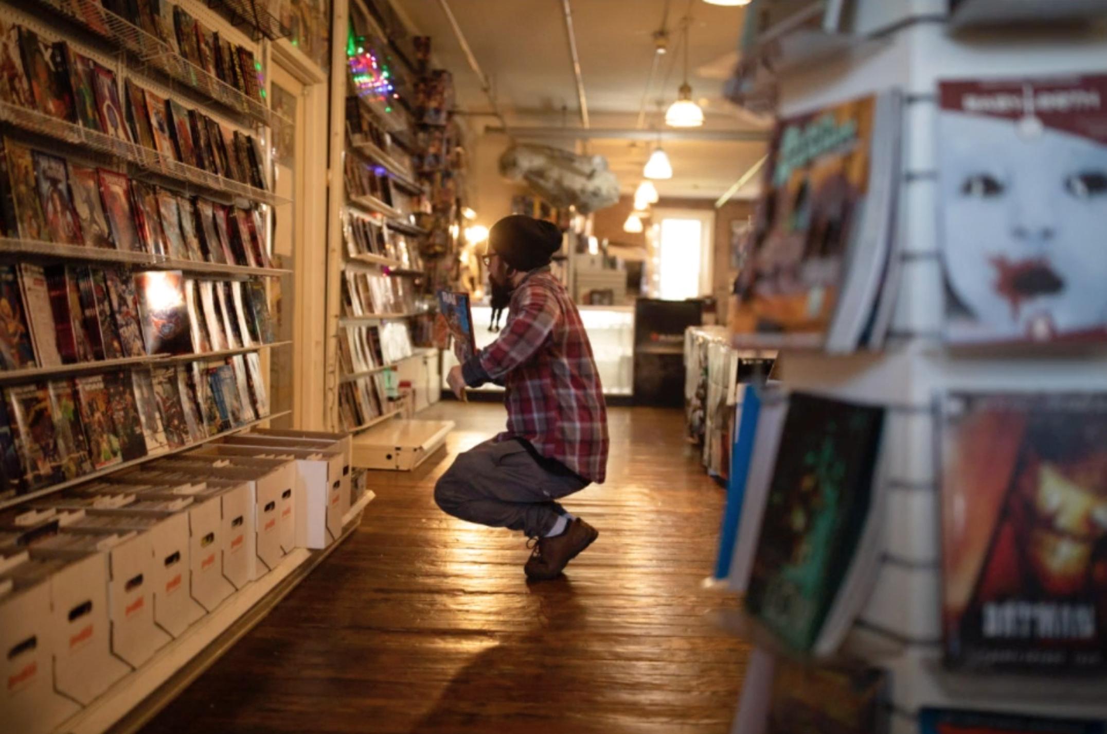 man in comic book shop