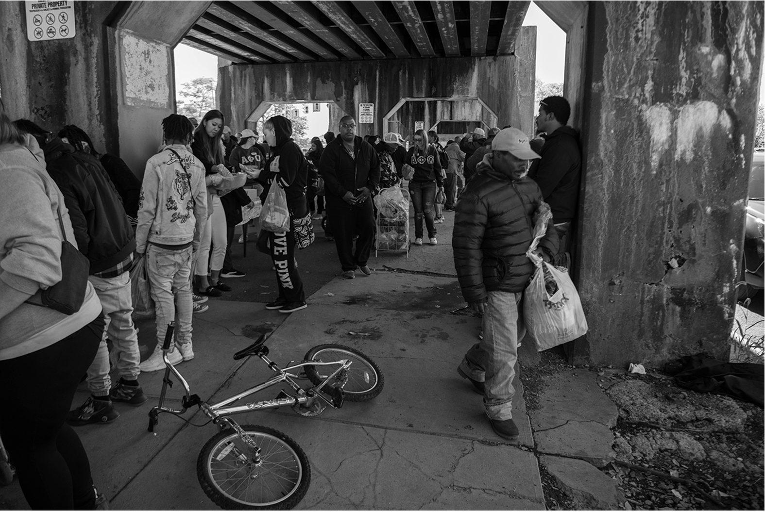 people under bridge